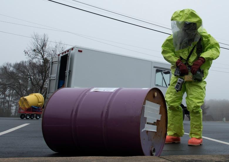 Airman 1st Class Cameron Butler, 4th Civil Engineer Squadron emergency management hazardous material team technician, examines a drum during a Hazardous Material Spill Response exercise, Dec. 9, 2019, in Goldsboro, N.C.