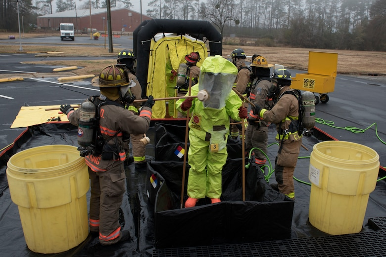 Members of the 4th Fighter Wing and the Goldsboro Fire Department, conduct decontamination procedures during a Hazardous Material Spill Response exercise, Dec. 9, 2019, in Goldsboro, N.C.