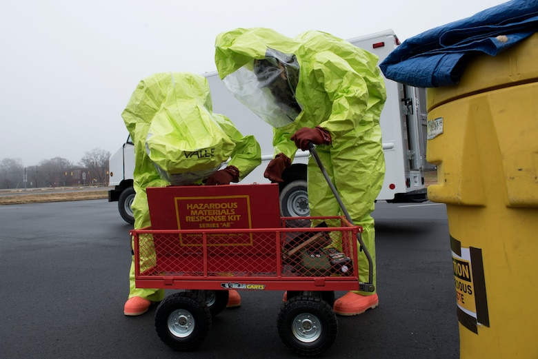 Members of the 4th Civil Engineer Squadron emergency management team, conduct hazardous material response procedures during a HAZMAT Spill Response exercise, Dec. 9, 2019, in Goldsboro, N.C.