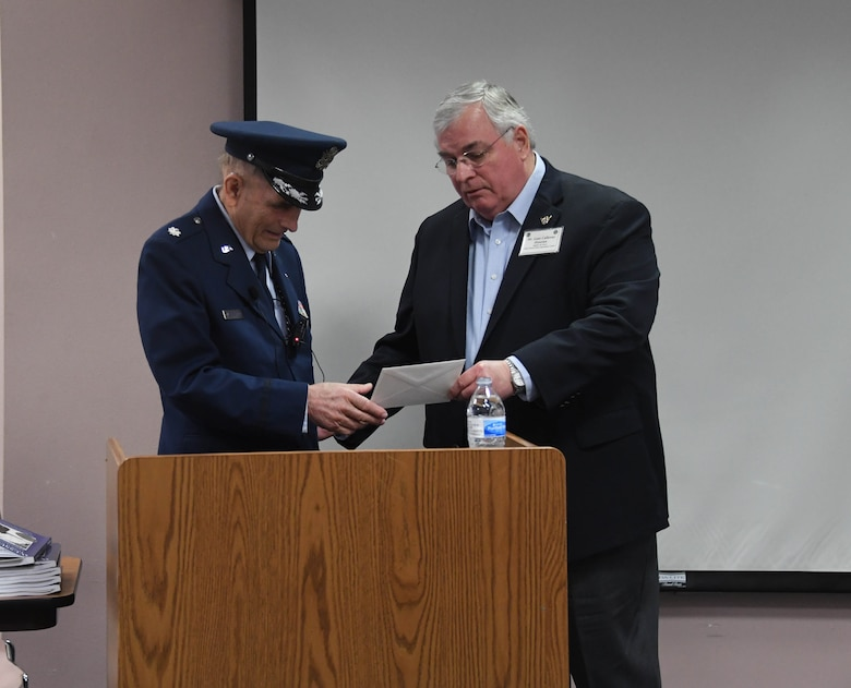 U.S. Air Force Lt. Col. Adolf Wesselhoeft tells what is was like growing up during the World War II and later as a member of 8th Air Force during a presentation at the History Center in Bossier City, La., Dec. 8, 2019. As a child of German immigrants (but born an American citizen), he and his parents were made to live in a U.S. internment camp during WW II until they were forced to return to Germany where they weathered severe bombings in Hamburg. Later on, Wesselhoeft returned to the U.S. and joined the military. He served as a photographer, navigator as well as a B-52 electronic warfare officer. He flew combat missions during the Vietnam War in the same unit (8th Air Force) that he lived through during WW II. Following Wesselhoeft' s address at the center, Lane Callaway, 8th Air Force historian, presented the veteran a letter of appreciation from Maj. Gen. James Dawkins Jr, current 8th Air Force commander, for his dedication and career service. (U.S. Air Force photo by Justin Oakes)