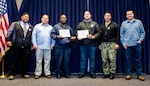 Mechanical Group (Code 930) Boiler Shop (Shop 41) mechanics Larry Montgomery (center left) and James Yung (center right) were recognized as the Third Quarter Cleanliness Warriors for their continuous efforts in cleanliness as well as their efforts as part of the USS George H.W. Bush (CVN 77) project. Both recepients were awarded a certificate of achievement, a Cleanliness Warrior sticker, a service award, and a C.O.R.E. award.