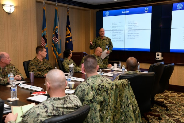 Navy Cmdr. Ryan Baum delivers an overview brief on DLA Disposition Services operations and the support provided from the team.