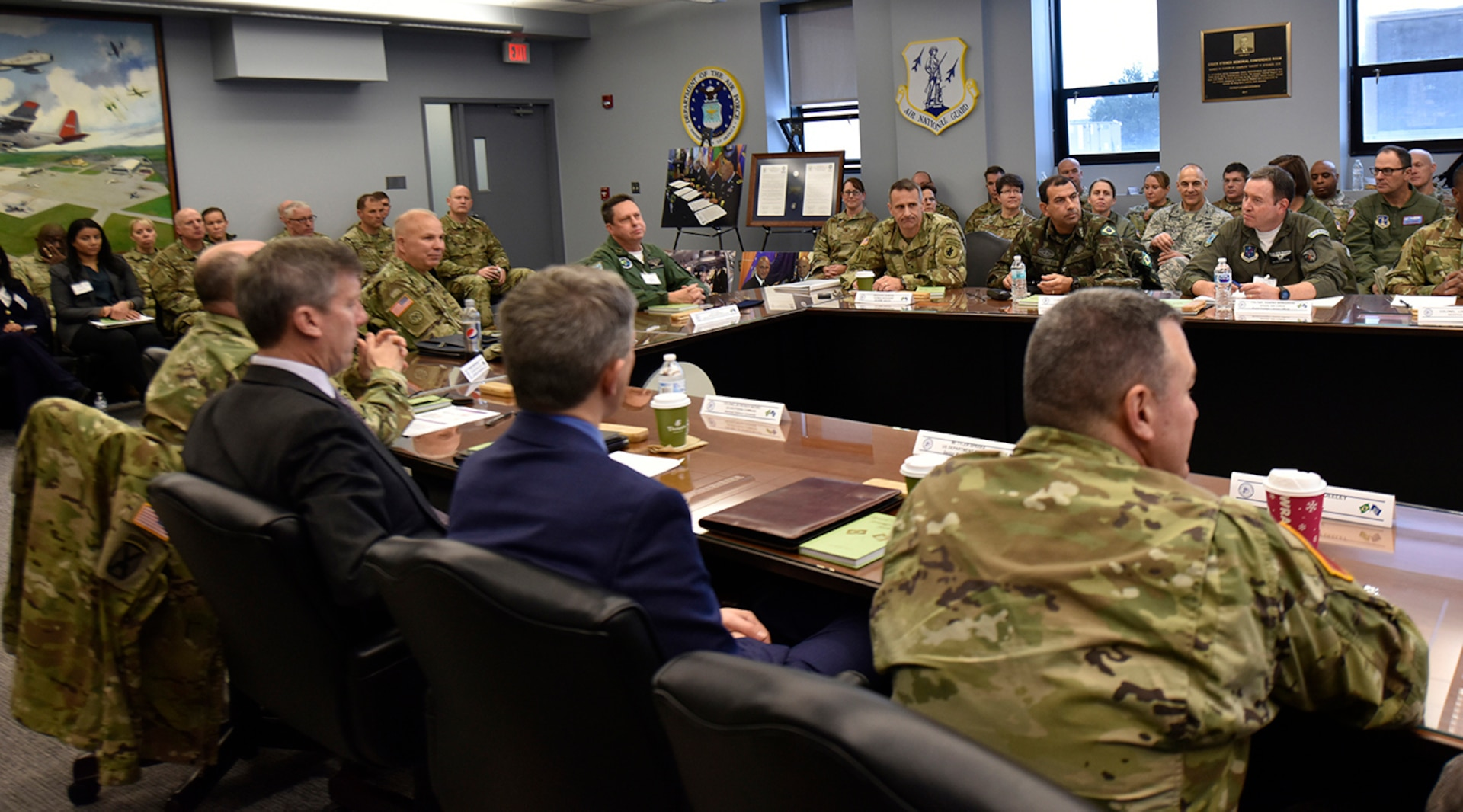 New York Army National Guard Maj.Gen.Ray Shields (center right), the adjutant general of New York, and Brazilian Maj. Gen. Marcio de Calazans Braga (center right), the Brazilian military attache in Washington, D.C., meet with members of the New York Air and Army National Guard and U.S. Southern Command and State Department representatives Dec. 11, 2019, at Stratton Air National Guard Base in Scotia, N.Y. The two-day meeting was held to discuss training and exchange opportunities as part of the National Guard State Partnership Program.