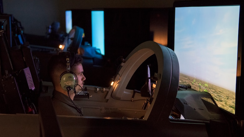 An Euro-NATO Joint Jet Pilot Training Program student pilot uses a training simulator at Sheppard Air Force Base, Texas, Dec. 10, 2019. The student will learn on these simulators and get familiar with the instrument panel, controls, levers, taxiing, take offs, landings and basic flying before being able to get into an actual aircraft. (U.S. Air Force photo by Senior Airman Pedro Tenorio)