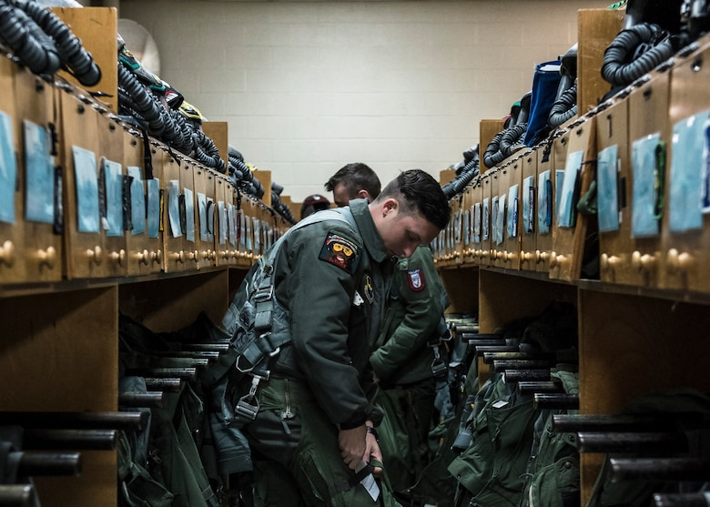 Euro-NATO Joint Jet Pilot Training Program student pilots gear up at Sheppard Air Force Base, Texas, Dec. 10, 2019. Sheppard has pilots training almost 24/7 around the clock. Pilots either have mandatory flying times or could voluntarily sign up for extra training. With so many planes coming in and out of Sheppard, pilots have a strict schedule of where and when to be, including a set amount of time to gear up and get out to their plane. (U.S. Air Force photo by Senior Airman Pedro Tenorio)