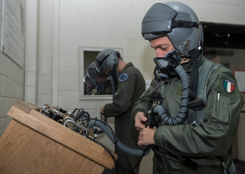 Euro-NATO Joint Jet Pilot Training Program student pilots check their equipment before flying at Sheppard Air Force Base, Texas, Dec. 10, 2019. The pilots get their gear fitted first by the Aircrew Flight Equipment Airmen, but after the initial fitting, they will mostly be gearing up and preparing their equipment themselves. (U.S. Air Force photo by Senior Airman Pedro Tenorio)