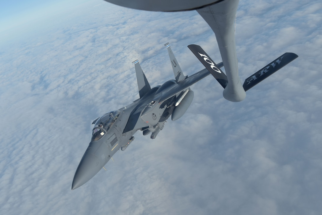 A U.S. Air Force F-15E Strike Eagle assigned to the 492nd Fighter Squadron, RAF Lakenheath, England, peels away after receiving fuel from a 100th Air Refueling Wing KC-135 Stratotanker during the Allied Combat Lethality Exercise over Poland, Dec. 10, 2019. Participation in multinational exercises enhance professional relationships and improves overall coordination with allies and partner militaries during times of crisis. (U.S. Air Force photo by Senior Airman Benjamin Cooper)
