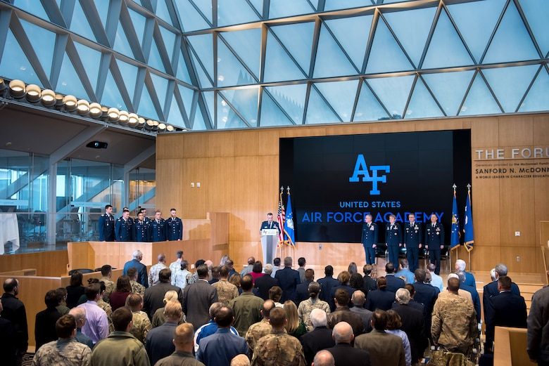 Academy superintendent, Lt. Gen. Jay Silveria, formally invested Col. Richard Cooney, department of behavioral sciences and leadership, and Col. Douglas Wickert, department of aeronautics, during an investiture ceremony in Polaris Hall at the U.S. Air Force Academy, Colo., Dec. 6, 2019. The Senate confirms the president's nomination for each of the permanent professor positions which is a final stop in an Air Force career. (U.S. Air Force photo by Trevor Cokley)