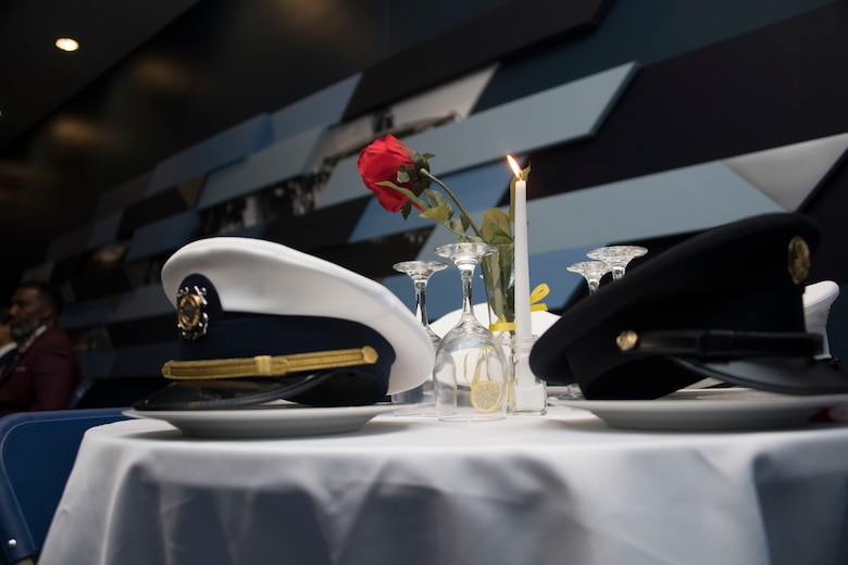 """Hats representing different branches of the military rest on a """"Missing Man Table"""" during the 1st Helicopter Squadron's 50th anniversary gala at Joint Base Andrews, Md., Dec. 6, 2019."""
