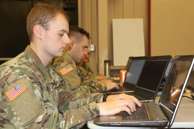 Troops operate computers.