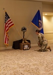 A Soldier kneels in front of a Battlefield Cross memorializing the fallen Minnesota Army National Guard Soldiers who died Dec. 5, 2019, in a UH-60 Black Hawk Helicopter crash outside St. Cloud, Minn. The memorial was posted outside a ballroom at the fiscal year 2020 Aviation Safety and Standardization Conference in Tucson, Ariz.