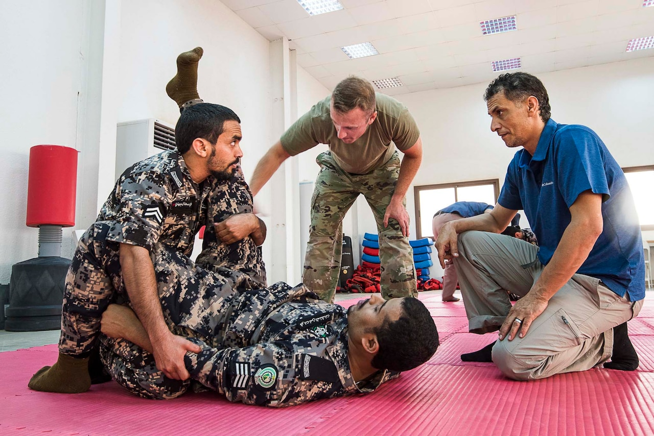 Soldiers conduct self-defense training.