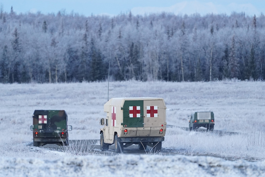 Army medics drive to their staging areas before paratroopers assigned to the 4th Infantry Brigade Combat Team (Airborne), 25th Infantry Division, U.S. Army Alaska, conduct a parachute jump on Malemute drop zone at Joint Base Elmendorf-Richardson, Alaska, Dec. 11, 2019. The Soldiers are part of the Army's only Pacific airborne brigade with the ability to rapidly deploy worldwide, and are trained to conduct military operations in austere conditions.