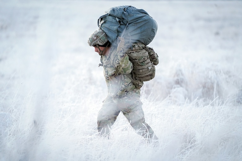 Army Capt. Edgar Burgos, assigned to the 3rd Battalion, 509th Parachute Infantry Regiment, 4th Infantry Brigade Combat Team (Airborne), 25th Infantry Division, U.S. Army Alaska, makes his way to a rally point after conducting a parachute jump on Malemute drop zone at Joint Base Elmendorf-Richardson, Alaska, Dec. 11, 2019. The Soldiers are part of the Army's only Pacific airborne brigade with the ability to rapidly deploy worldwide, and are trained to conduct military operations in austere conditions.