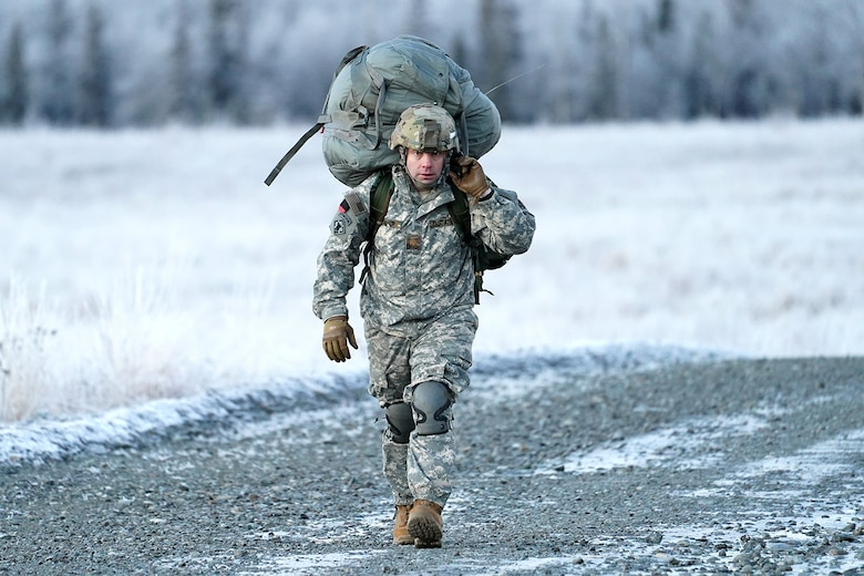 Army Maj. David Dawes, assigned to the 6th Brigade Engineer Battalion (Airborne), 4th Infantry Brigade Combat Team (Airborne), 25th Infantry Division, U.S. Army Alaska, makes his way to a rally point after conducting a parachute jump on Malemute drop zone at Joint Base Elmendorf-Richardson, Alaska, Dec. 11, 2019. The Soldiers are part of the Army's only Pacific airborne brigade with the ability to rapidly deploy worldwide, and are trained to conduct military operations in austere conditions.