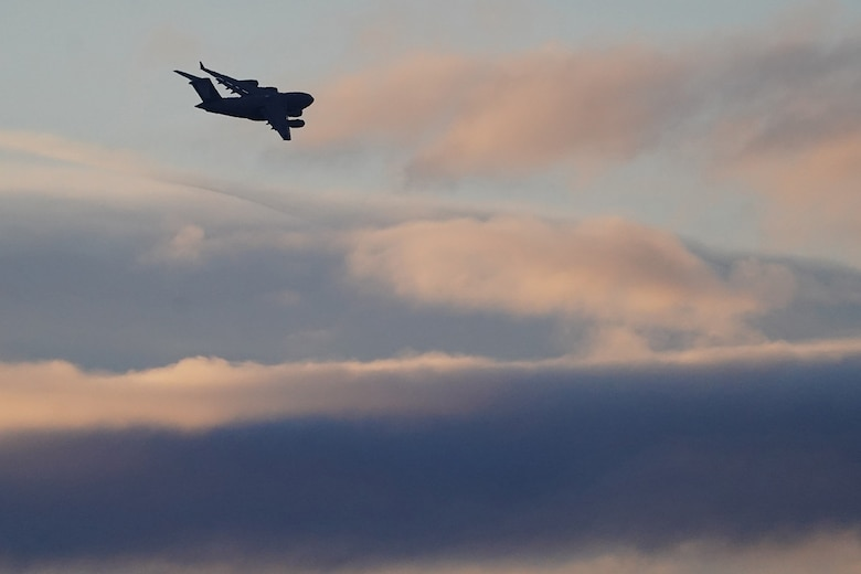 A C-17 Globemaster III banks in the early morning light after paratroopers assigned to the 4th Infantry Brigade Combat Team (Airborne), 25th Infantry Division, U.S. Army Alaska, conducted a parachute jump on Malemute drop zone at Joint Base Elmendorf-Richardson, Alaska, Dec. 11, 2019. The Soldiers are part of the Army's only Pacific airborne brigade with the ability to rapidly deploy worldwide, and are trained to conduct military operations in austere conditions.