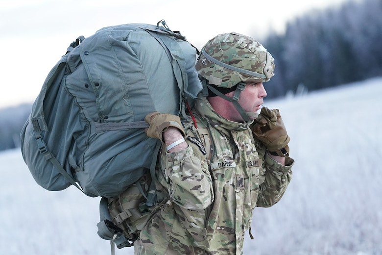 Army 1st Sgt. George Barbine, assigned to the 1st Battalion, 501st Parachute Infantry Regiment, 4th Infantry Brigade Combat Team (Airborne), 25th Infantry Division, U.S. Army Alaska, makes his way to a rally point after conducting a parachute jump on Malemute drop zone at Joint Base Elmendorf-Richardson, Alaska, Dec. 11, 2019. The Soldiers are part of the Army's only Pacific airborne brigade with the ability to rapidly deploy worldwide, and are trained to conduct military operations in austere conditions.