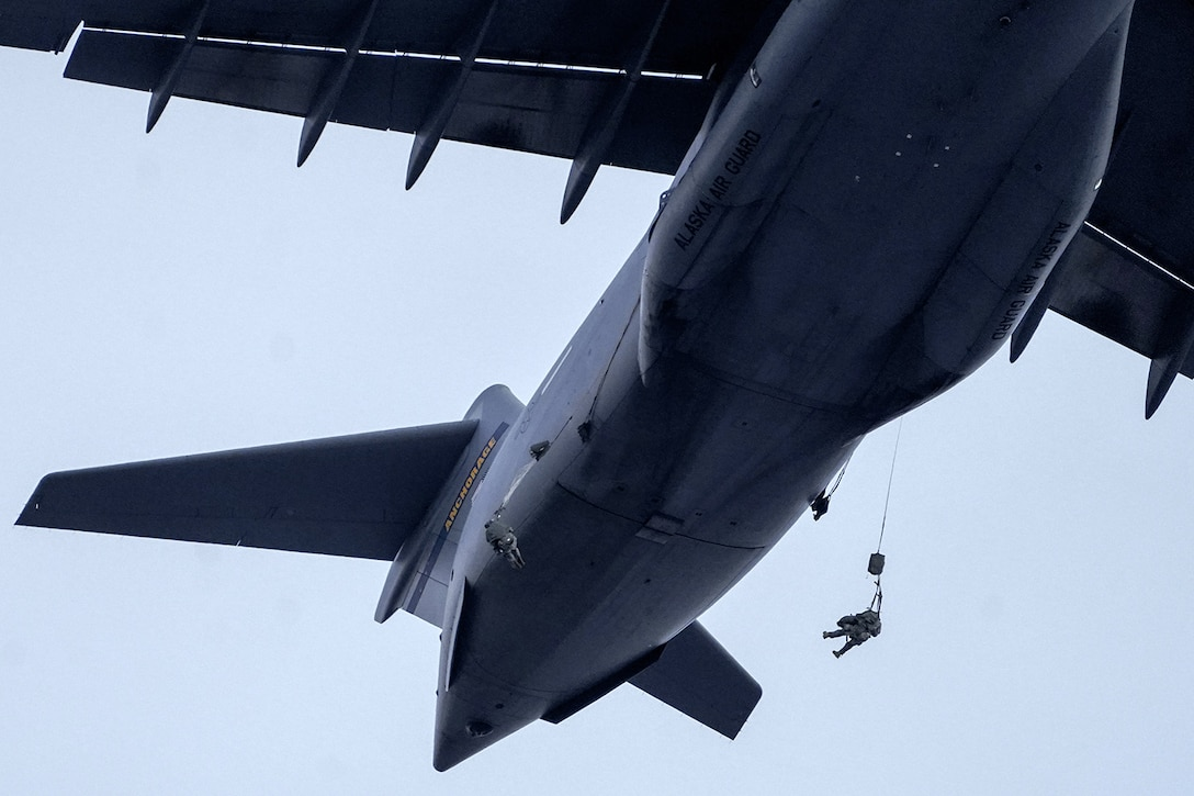 Paratroopers assigned to the 4th Infantry Brigade Combat Team (Airborne), 25th Infantry Division, U.S. Army Alaska, conduct a parachute jump on Malemute drop zone at Joint Base Elmendorf-Richardson, Alaska, Dec. 11, 2019. The Soldiers are part of the Army's only Pacific airborne brigade with the ability to rapidly deploy worldwide, and are trained to conduct military operations in austere conditions.