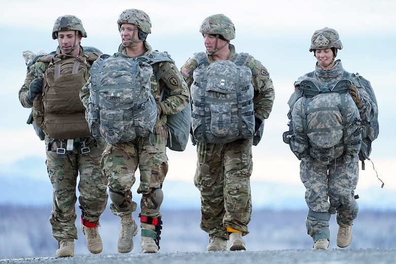 Soldiers assigned to the 4th Infantry Brigade Combat Team (Airborne), 25th Infantry Division, U.S. Army Alaska, makes their way to a rally point after conducting a parachute jump on Malemute drop zone at Joint Base Elmendorf-Richardson, Alaska, Dec. 11, 2019. The Soldiers are part of the Army's only Pacific airborne brigade with the ability to rapidly deploy worldwide, and are trained to conduct military operations in austere conditions.