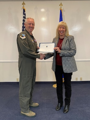 Sheryl Tierney, Engineering Development Office Chief, and Col. Kirk Reagan, 412th Test Wing Vice Commander, pose for a photo during her graduation ceremony from the first ever Civilian Leadership School at Edwards Air Force Base, California. (Courtesy photo)