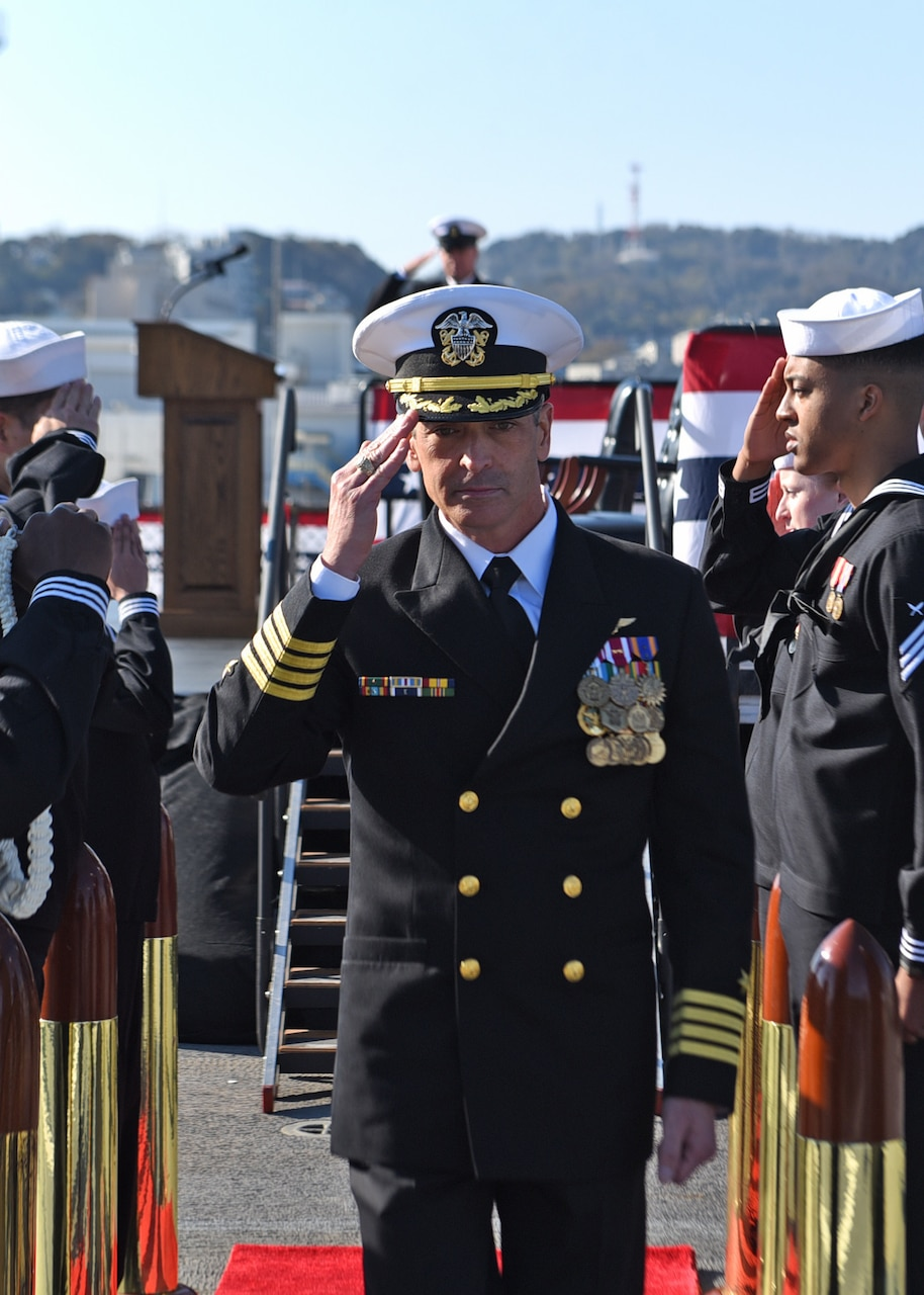 YOKOSUKA, Japan (Dec. 12, 2019) Commanding Officer Capt. Craig Sicola, from Dallas, proceeds through sideboys during the U.S. 7th Fleet flagship USS Blue Ridge (LCC 19) change of command ceremony. Sicola, of Dallas, relieved Capt. Eric J. Anduze, from Manati, Puerto Rico, as the ship's commanding officer. Blue Ridge, part of Expeditionary Strike Group 7, is the oldest operational ship in the Navy and, as 7th Fleet command ship, actively works to foster relationships with allies and partners in support of security and stability within the Indo-Pacific Region.