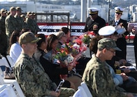 YOKOSUKA, Japan (Dec. 12, 2019) USS Blue Ridge (LCC 19) honored guests receive flowers during the U.S. 7th Fleet flagship change of command ceremony. Capt. Craig C. Sicola, of Dallas, relieved Capt. Eric J. Anduze, from Manati, Puerto Rico, as the ship's commanding officer. Blue Ridge, part of Expeditionary Strike Group 7, is the oldest operational ship in the Navy and, as 7th Fleet command ship, actively works to foster relationships with allies and partners in support of security and stability within the Indo-Pacific Region.
