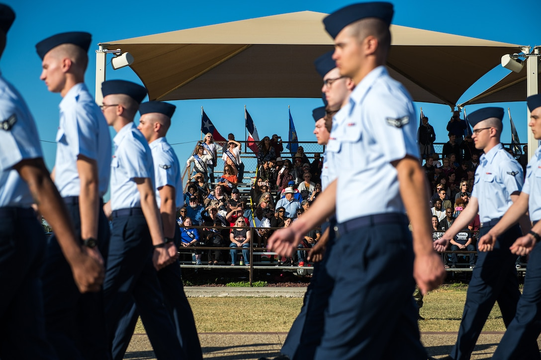 The women of flight W039, 3707th Squadron, of 1979, and their families, attend the U.S. Air Force basic military training graduation parade, Oct. 18, 2019, at Joint Base San Antonio-Lackland, Texas.