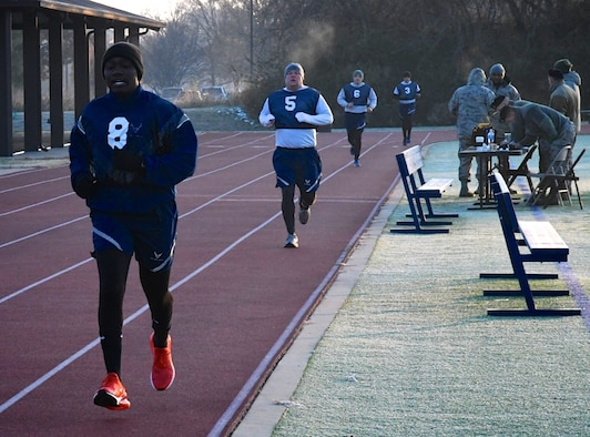 "Airmen of the Air Force Reserve Command in Illinois complete lap three of six recently.  These 932nd Airlift Wing Citizen Airmen reservists performed the 1.5 mile run as part of the Air Force fitness assessment November 16, 2019, at Scott Air Force Base, Illinois. The weather was a bit chilly at 6:30 a.m., but winds were calm and pleasantly warmed up once the sun rose . Reservists from more than 30 states come to train each month at the Illinois C-40C unit known among reserve units as the ""Gateway Wing"". Fitness test also include pushups, sit-ups and height and weight measurements. Staying fit throughout the year helps keep Airmen ready for any future challenges.  (U.S. Air Force photo by Lt. Col. Stan Paregien)"