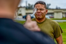 U.S. Marines and sailors aboard Marine Corps Base-Camp Smedley D. Butler get oleoresin capsicum sprayed during the Security Augmentation Force Training from Dec. 6, 2019 on Camp Foster, Okinawa, Japan.