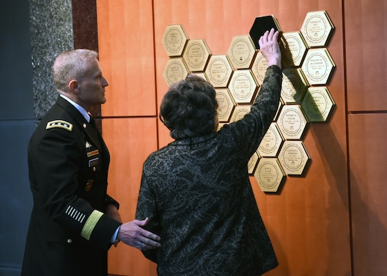 Defense Intelligence Agency Director Lt. Gen. Robert Ashley Jr. looks on as Dr. Blanka Shadrin unveils her husband's plaque on the DIA Patriots Memorial. After defecting from the Soviet Union, Nicholas Shadrin worked at DIA while also serving as a double agent for the FBI. On a mission in Vienna in 1975, Shadrin was abducted by the KGB and killed from a sedative overdose.