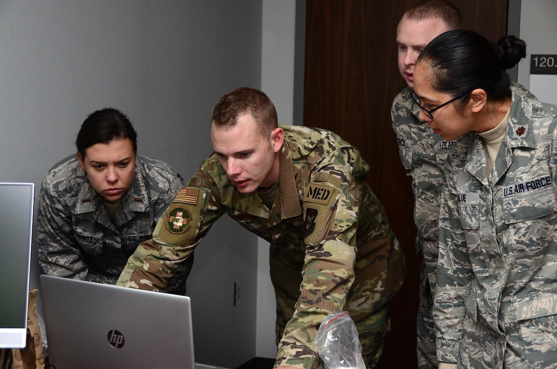 445th Aeromedical Staging Squadron Airmen run tests on a SimMan ALS manikin, Nov. 2, 2019. These ASTS members will become the training cadre for the medical technicians and nurses from all three medical units at the 445th Airlift Wing; 445th ASTS, 445th Aeromedical Evacuation Squadron and 445th Aerospace Medicine Squadron. The manikin's advanced construction and computer systems allows the cadre to simulate illnesses for those training to identify and treat. ASTS was designated as the keeper of the $45,000 manikin.