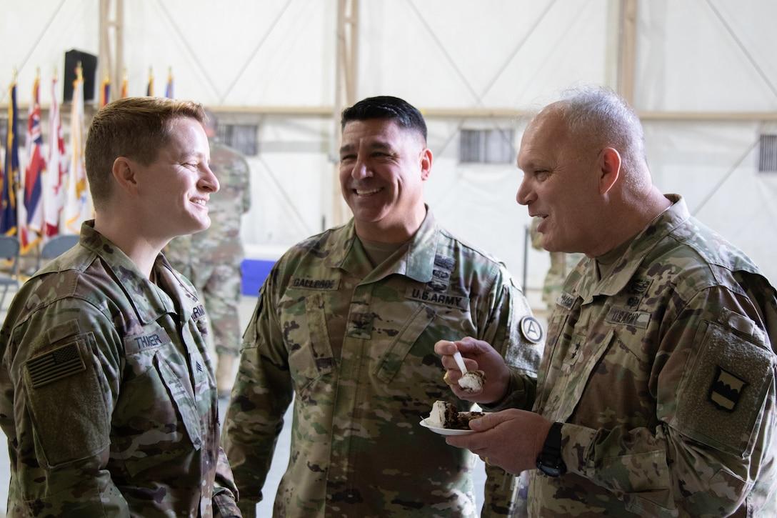 Maj. Gen. Bruce E. Hackett greets troops