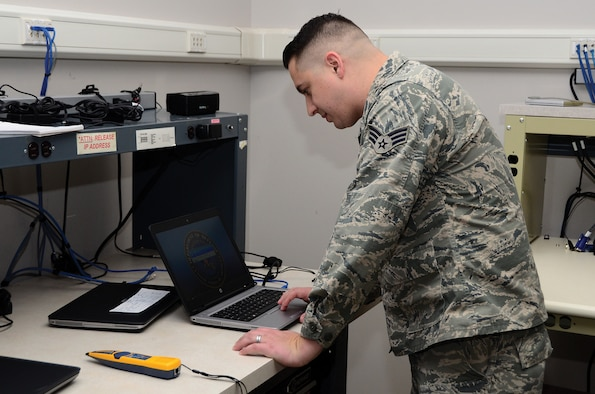 Senior Airman Kevin Jones, 445th Force Support Squadron, Communications Element client systems technician, re-images a laptop for a customer Nov. 2, 2019 on the imaging bench. Re-imaging the laptop allows Jones to rebuild the network profile and gives the machine the most up to date Windows version. (Photo by Staff Sgt. Darrell Sydnor)