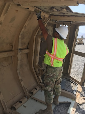 After flipping the vehicle the inspection for contraband by Navy Petty Officer Second Class Jhunar Medenilla only finds only a partial ammunition link and one AA battery.