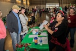 "Colorado National Guard Family Program members speak with a CONG family at the annual CONG Family Program Santa Shop Dec. 15, 2018, in Denver, Colorado. This program allows National Guard families to ""shop"" for free gifts during the holiday season. Colorado communities donate gifts annually to CONG Families Programs, in advance of the holiday season. (U.S. Army National Guard photo by Staff Sgt. Joseph K. VonNida)"