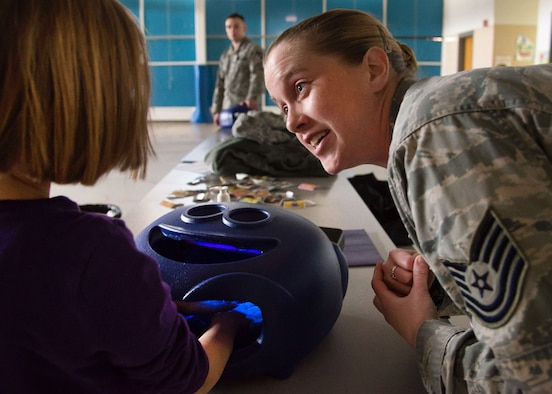 Tech. Sgt. Jennifer Maddox, 66th Medical Squadron Public Health technician, explains the importance of hand-washing to Emma Pottratz at the Hanscom Primary School April 5, 2016. Officials from the 66 MDS are encouraging the Hanscom community to practice thorough and regular hand washing to combat cold and flu season. (U.S. Air Force photo by Mark Herlihy)