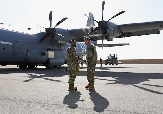 U.S. Air Force Brig. Gen. Ronald Jolly, left, U.S. Air Forces in Europe and Air Forces Africa director of logistics, engineering and force protection, speaks with Col. Jonathan Creer, 409th Air Expeditionary Group commander, at Nigerien Air Base 201, Agadez, Niger, Dec. 11, 2019. During his visit to the continent, Jolly traveled across West Africa to discuss the West African Logistics Network with local partners in the region and tour military installations where U.S. Airmen live and work. (U.S. Air Force photo by Staff Sgt. Alex Fox Echols III)