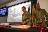 U.S. Army Lt. Col. Jennifer Green, a member of Joint Task Force Civil Support's (JTF-CS) J5 directorate, and JTF-CS Command Senior Enlisted Leader U.S. Air Force Chief Master Sgt. James Brown participate in a cake cutting to commemorate the U.S. National Guard's 383rd birthday. (DoD Photo by Chief Mass Communication Specialist Barry Riley/RELEASED)