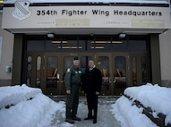 U.S. Air Force Col. Benjamin Bishop, 354th Fighter Wing commander, and Honorable John Rood, Under Secretary of Defense for Policy, pose for a photo outside of Amber Hall on Eielson AFB, AK, Dec. 9, 2019.