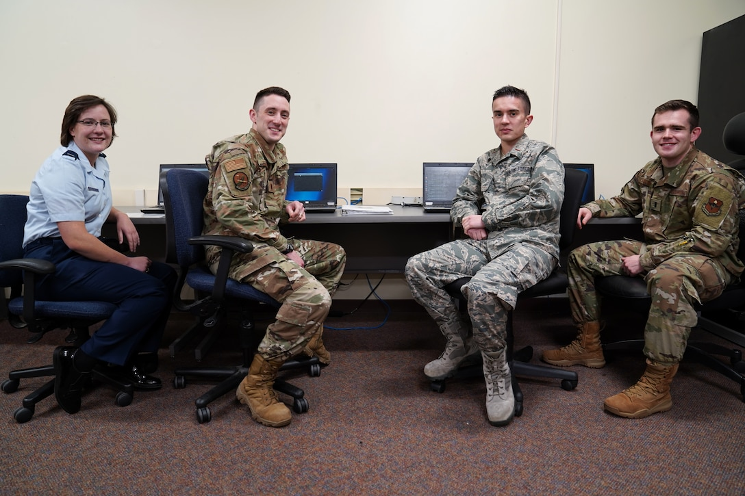 U.S. Air Force Airmen, President's Cybersecurity Cup competition team, pose for a photo inside Stennis Hall at Keesler Air Force Base, Dec. 12, 2019. The competition was initiated by President Donald Trump to strengthen cybersecurity across the nation and Department of Defense. (U.S. Air Force photo by Airman Seth Haddix)