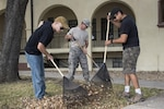 Tech. Sgt. Chuck Blades, Master Sgt. Eddie Martin and Master Sgt. Rick Mireles, Air Education and Training Command Studies Analysis Squadron aircraft systems test managers, rake leaves at the AETC headquarters building during Joint Base San Antonio Proud Week Oct. 7, 2015, at JBSA-Randolph. Proud Week gives JBSA members an opportunity to pause from daily operations and focus on maintaining a high beautification standard throughout JBSA.