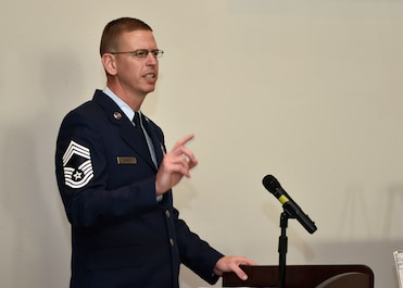 Chief Master Sgt. Jon Neidigh, 47th Operations Support Squadron radar approach control chief controller at Laughlin Air Force Base, speaks to the graduates of Airman Leadership School Class 20-A during the their ceremony at the event center on Goodfellow Air Force Base, Texas, December 12, 2019. Neidigh spoke about how important it is for the graduates to not be afraid to make mistakes and learn from them. (U.S. Air Force photo by Airman 1st Class Robyn Hunsinger)