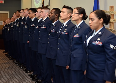 Graduates of Airman Leadership School Class 20-A prepare to sing the Air Force Song during the ALS Graduation ceremony at the event center on Goodfellow Air Force Base, Texas, December 12, 2019. ALS is a four-week course designed to prepare senior airmen to assume supervisory duties. (U.S. Air Force photo by Airman 1st Class Robyn Hunsinger)