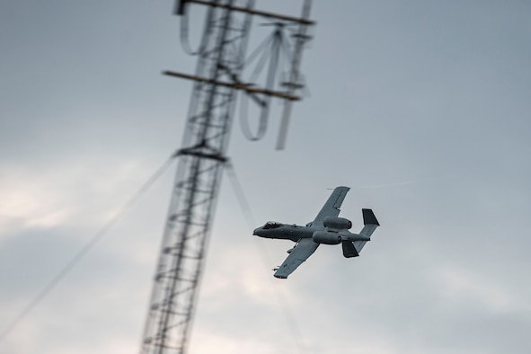 Photo of an A-10C Thunderbolt II completing a pass.