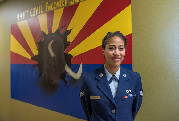 As an accomplished artist, Simmons saw an opportunity to share her abilities with her squadron. Through crafting a mural depicting the squadron heritage and logo, Simmons is credited with not only boosting morale, but helping to sustain the squadron's heritage.
