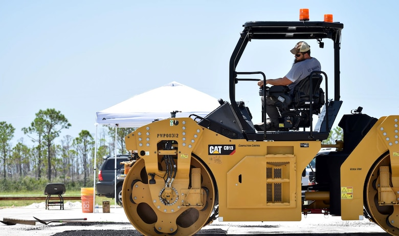 As part of the final phase off capping a crater, the pavements team with the Air Force Civil Engineer Center uses a steel drum compactor at the backfill event on July 16, 2019 at the 9700 Area at Tyndall Air Force Base, Florida. (U.S. Air Force photo by Grace Bland)