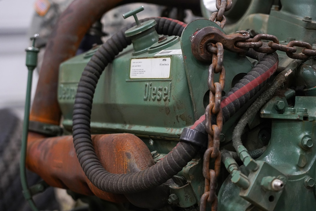 A damaged engine from an M984A2 Heavy Expanded Mobility Tactical Truck wrecker rests on jack stands in the 109th Transportation Company, 17th Combat Sustainment Support Battalion, U.S. Army Alaska, motor pool on Joint Base Elmendorf-Richardson, Alaska, Dec. 13, 2019. The M984A2 is an eight-wheel drive, diesel-powered, variant of the HEMTT used in vehicle recovery operations.