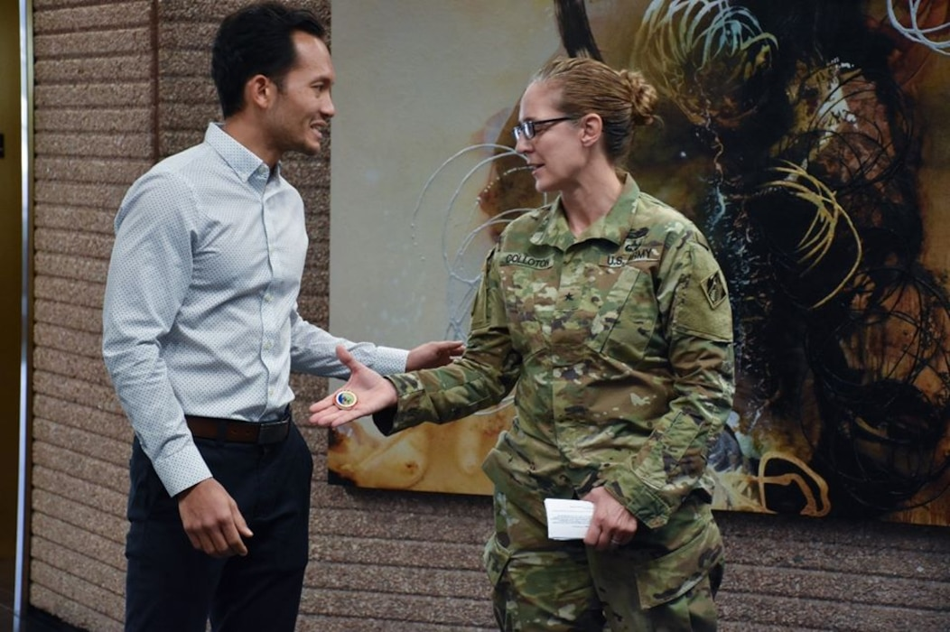 Honolulu District project manager Gabriel El-Swaify accepts a command coin from South Pacific Division (SPD) Commander Brig. Gen. Kimberly Colloton last week for his excellence in managing 12 support contracts for SPD.