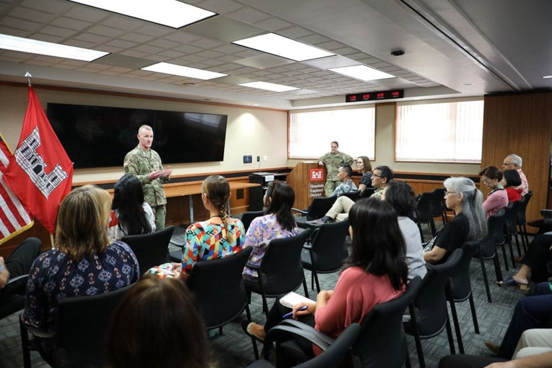 During a mini-town hall Dec. 2, U.S. Army Corps of Engineers Command Sgt. Maj. Bradley Houston discussed forthcoming Revolutionize USACE initiatives with District personnel and later visited District MILCON project sites at Fort Shafter and Schofield Barracks. During the townhall Houston awarded his signature USACE CSM coin to seven District employees for their excellence in delivering the District mission.
