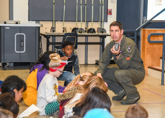 Maj. Ben Gilliland, Orange Flag Director, 411th Flight Test Squadron, explains GPS location navigation to a group of STARBASE Edwards Students at Edwards Air Force Base, California, Dec. 10. (Air Force photo by Giancarlo Casem)
